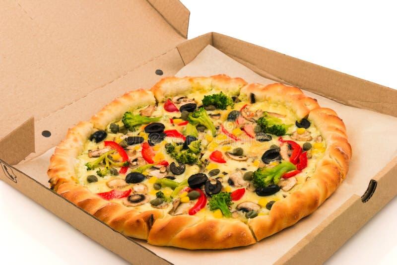 Pizza en caja de cartón foto de archivo