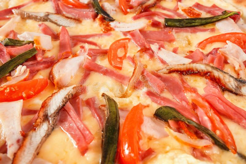 Pizza with fish eel, ham, pastrami and avocado on white royalty free stock images