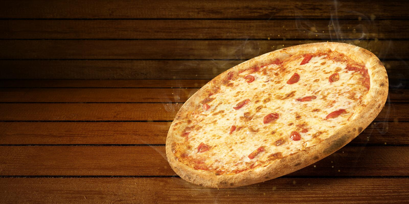 Pizza in flying on wooden table. Concept promotional flyer and poster for Restaurants or pizzerias, template with hot. Delicious pizza margarita closeup with royalty free stock photography