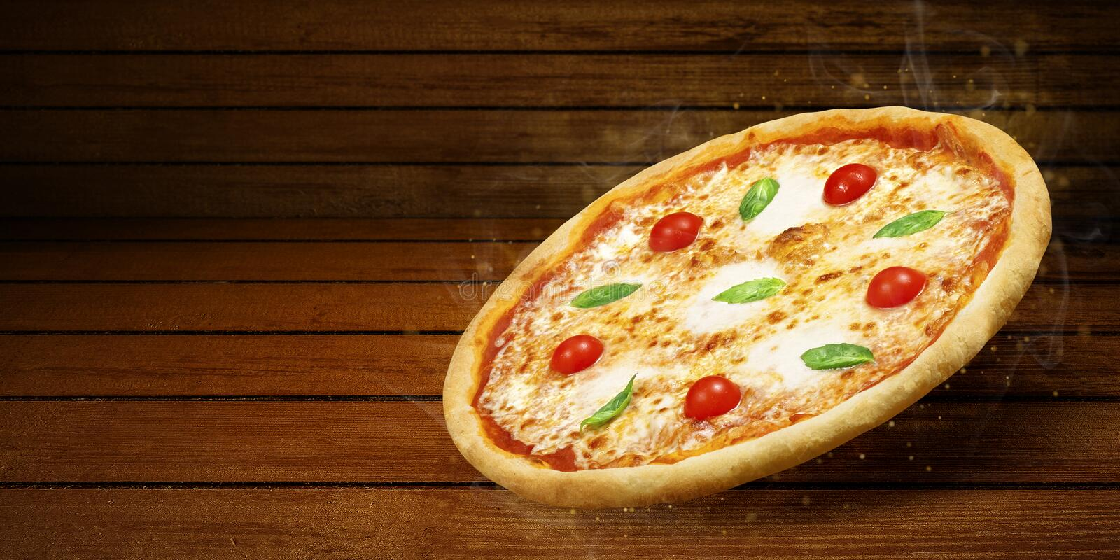 Pizza in flying on wooden table. Concept promotional flyer and poster for Restaurants or pizzerias, template with hot. Delicious pizza margarita closeup with royalty free stock photo