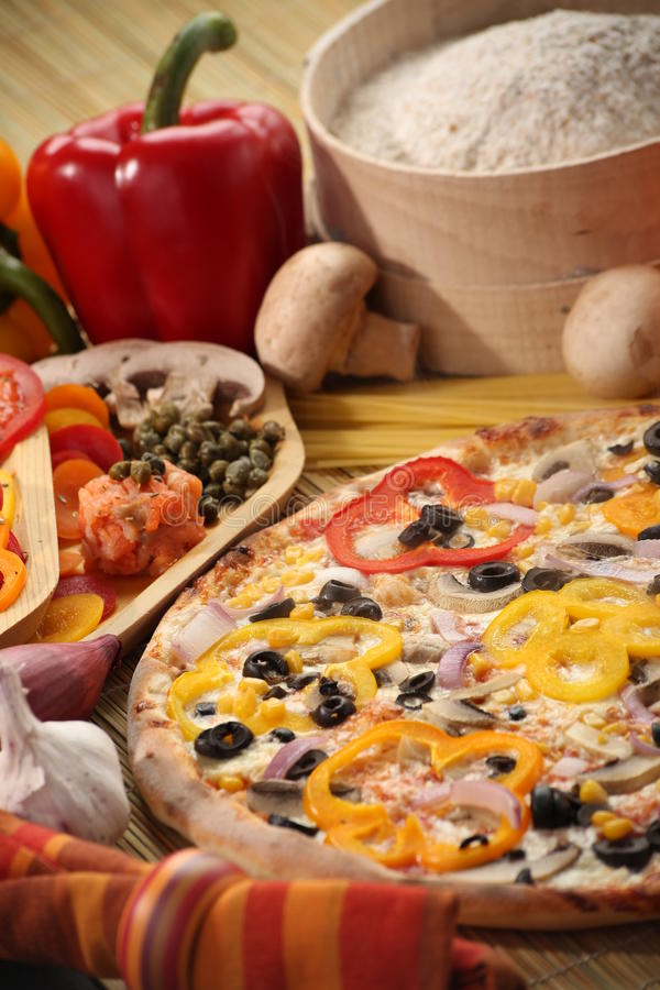 Pizza. Fresh and hot home made pizza with paprika royalty free stock photo