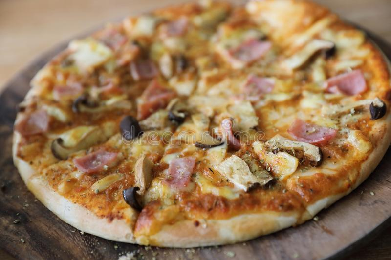 Pizza ham and mushroom royalty free stock images