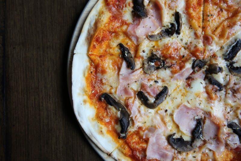 Pizza ham and mushroom on table wood stock images