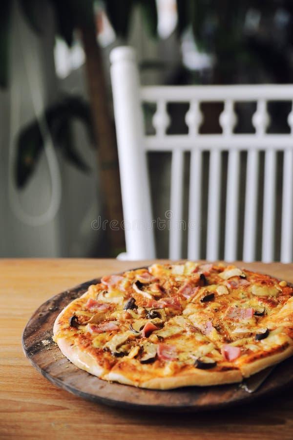 Pizza ham and mushroom royalty free stock image
