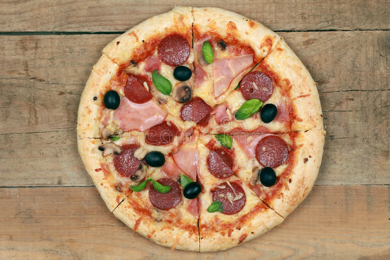 Pizza with ham and pepperoni stock photo
