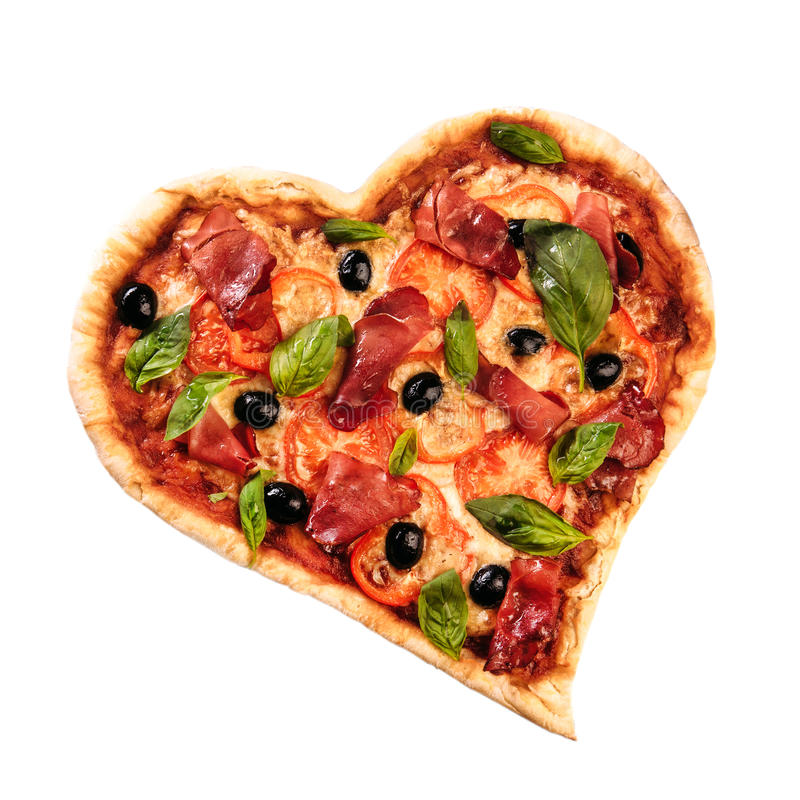 Pizza heart love Valentine`s Day romantic Italian restaurant dinner food. Prosciutto, olives, tomatoes, parsley, basil. And mozzarella cheese meal on black royalty free stock image