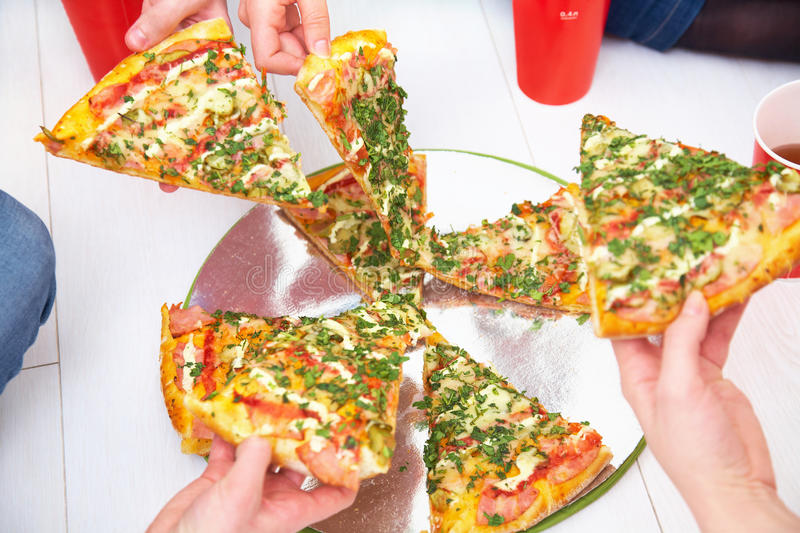 Pizza And Human Hands Royalty Free Stock Photos