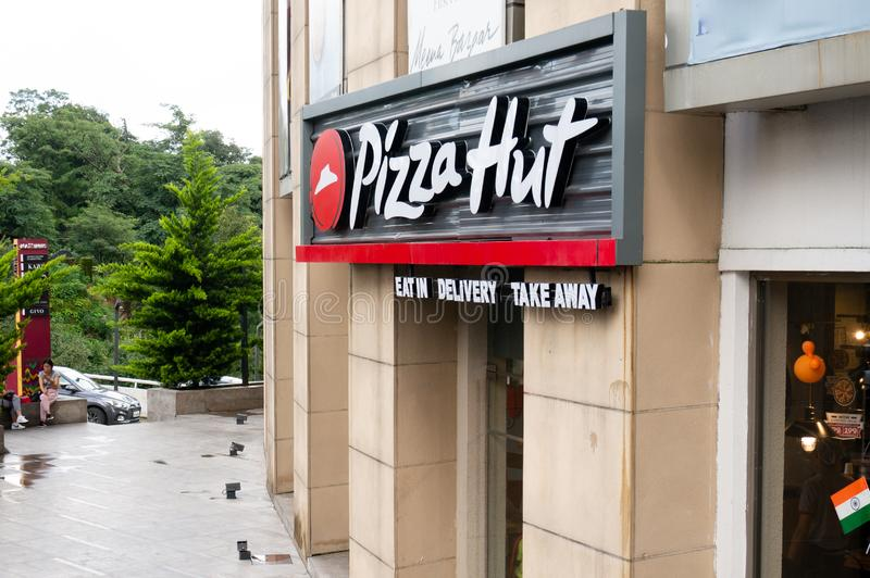 Outside of a pizza hut a popular fast food joint in Delhi india. Pizza hut, Delhi, India - circa 2019 : Outside of a deserted pizza hut in an old stone building stock photo