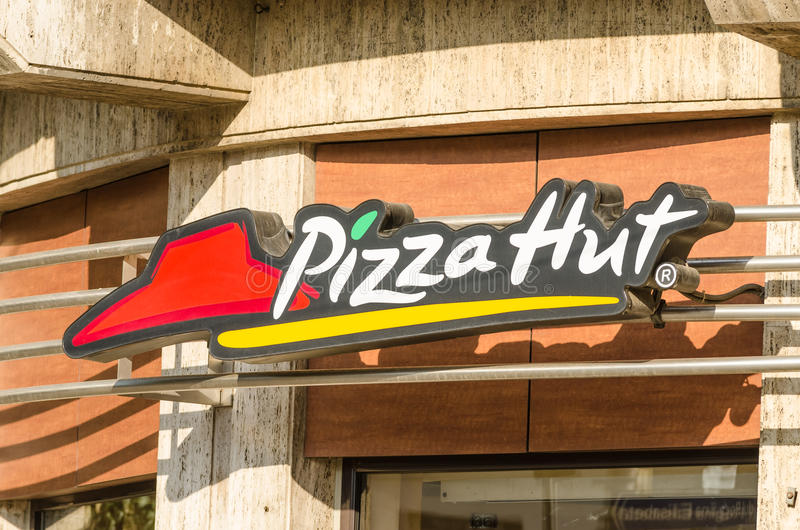 Pizza Hut Restaurant. BUCHAREST, ROMANIA - JUNE 14: Pizza Hut Restaurant Sign on June 14, 2013 in Bucharest, Romania. It is an American restaurant chain and stock images