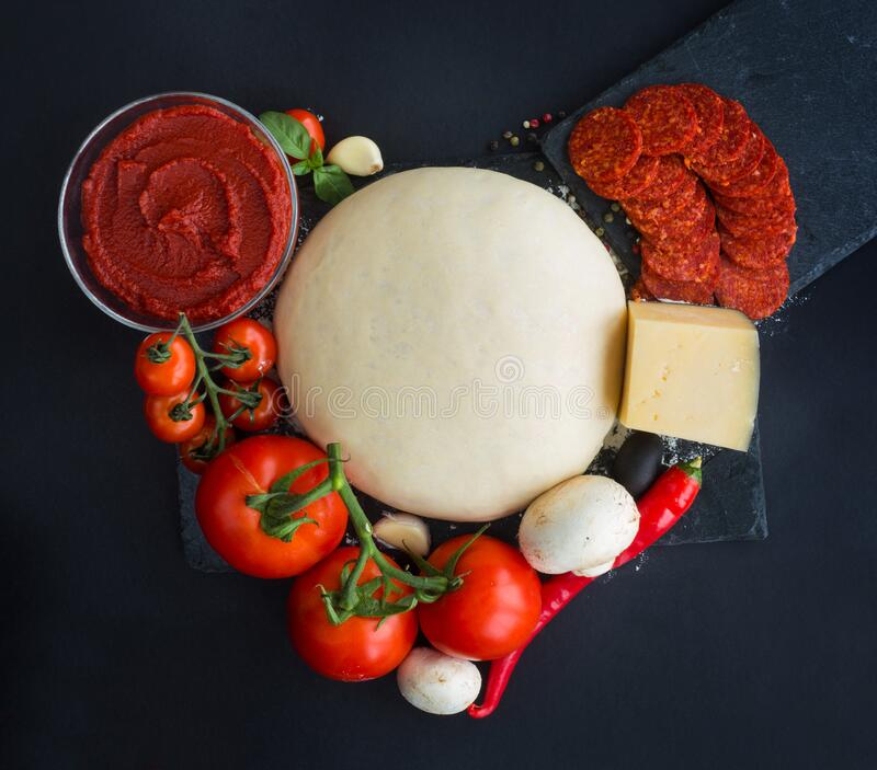 Pizza ingredients heart royalty free stock photography