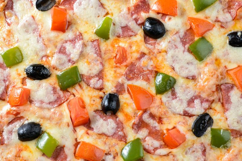 Pizza isolated on black. Segment of Hot Pizza isolated on black background stock photo