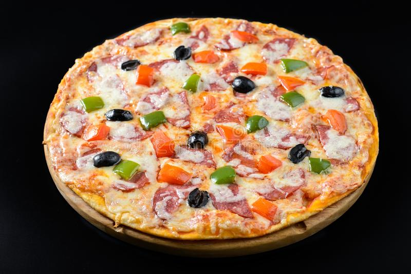Pizza isolated on black. Whole hot Pizza isolated on black background stock image
