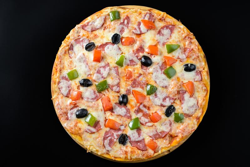 Pizza isolated on black. Whole hot Pizza isolated on black background stock photography