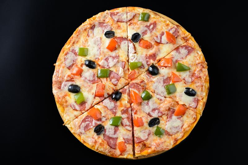 Pizza isolated on black. Whole hot Pizza isolated on black background royalty free stock photos