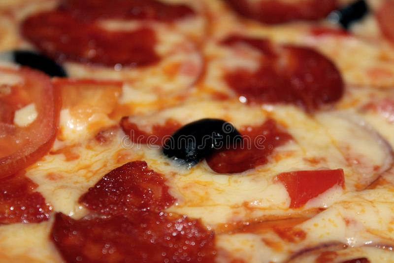 Diablo pizza with olives, smoked sausage royalty free stock photos