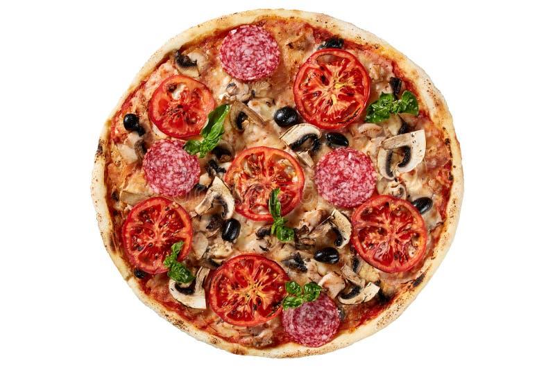 Pizza italiana deliziosa sopra bianco fotografie stock libere da diritti