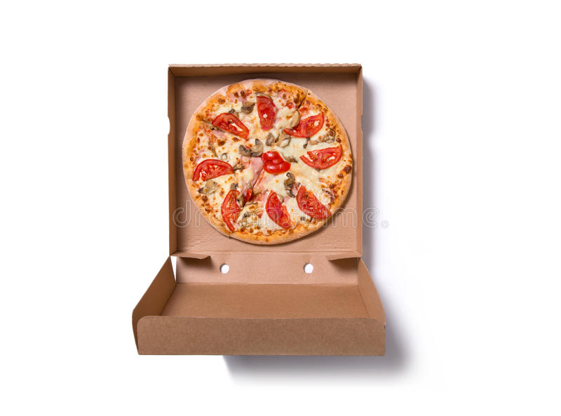 Pizza italiana saboroso fresca com presunto e tomates na caixa imagem de stock royalty free