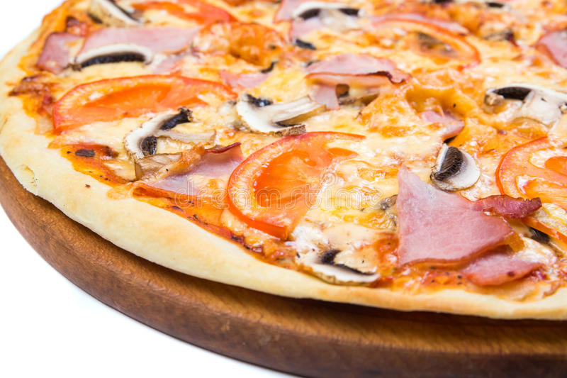 Pizza on light wooden. Background top view stock photography