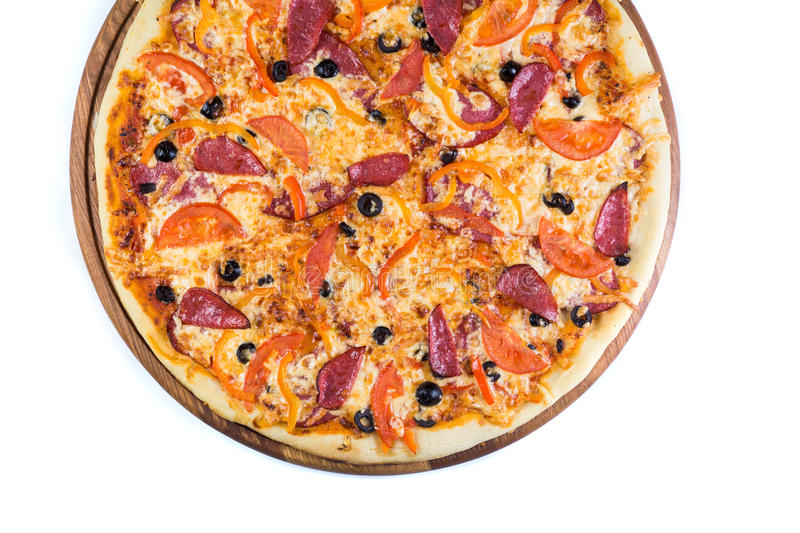 Pizza on light wooden. Background top view royalty free stock photography