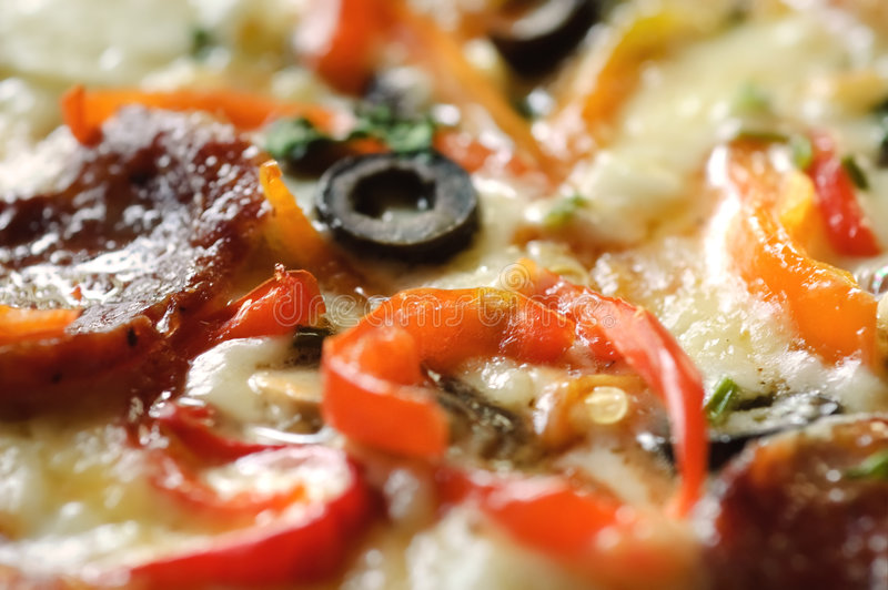 Pizza macro. Macro shot of pizza surface, selective focus royalty free stock images