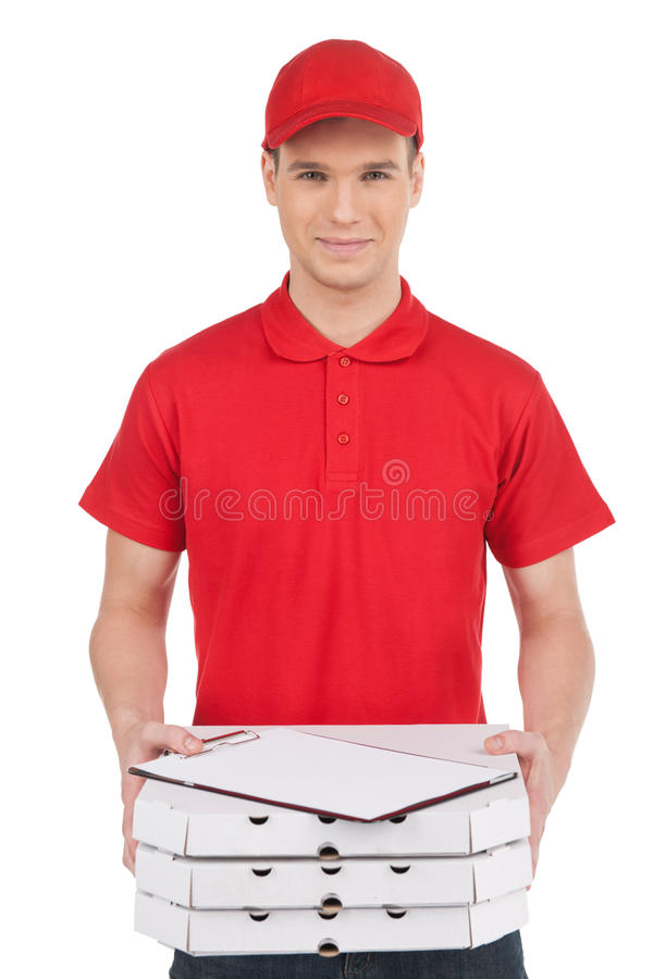 Pizza man with a stack of pizza boxes. Front view of young cheer. Ful pizza man holding a stack of pizza boxes and clipboard on it while isolated on white stock photography