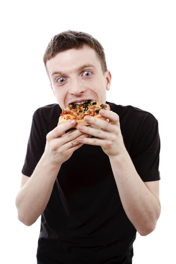 Pizza mangiatrice di uomini fotografie stock
