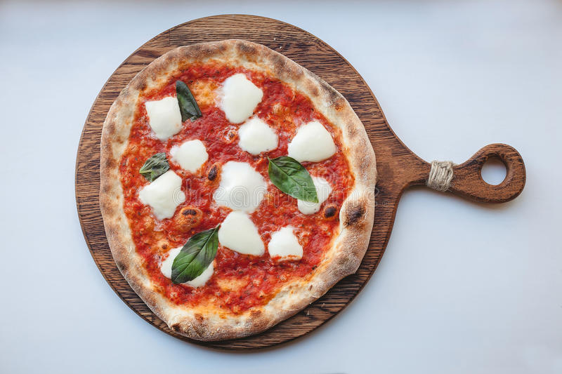 Pizza Margherita. Italian white background top view royalty free stock images