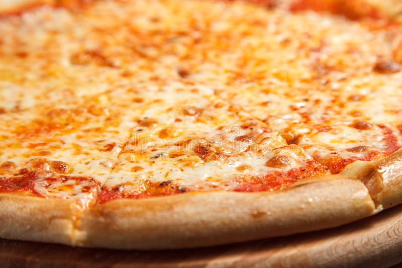Pizza Margherita made with Tomatoes, Gauda Cheese and Mozzarella stock image