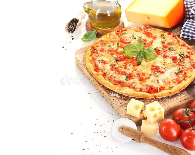 Pizza Margherita på vit bakgrund royaltyfria bilder