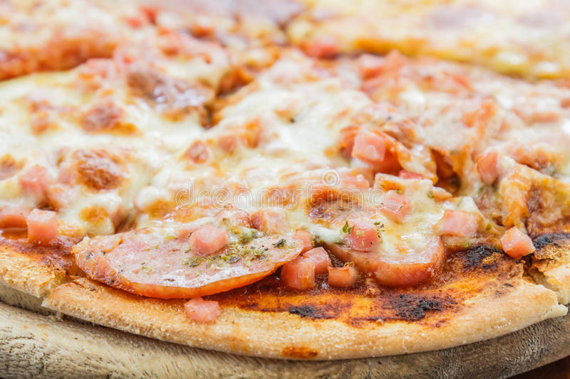 Pizza Meat Lover and cheese. Pizza Meat lover with sausage, salami, ham, bacon, pepperoni and cheese in restaurant royalty free stock photo