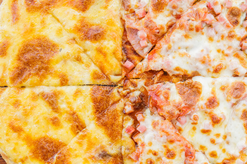 Pizza Meat Lover and cheese. Pizza Meat lover with sausage, salami, ham, bacon, pepperoni and cheese in restaurant.top view royalty free stock photography
