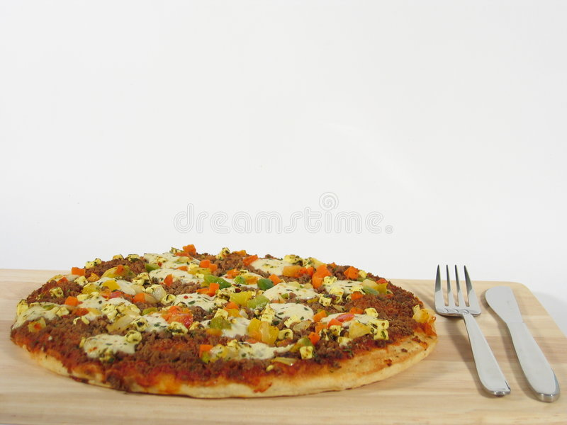Pizza met Bestek stock foto