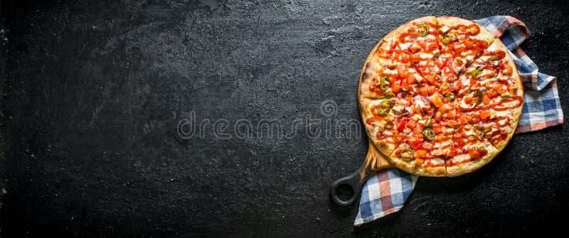 Pizza mexicaine avec une serviette image libre de droits