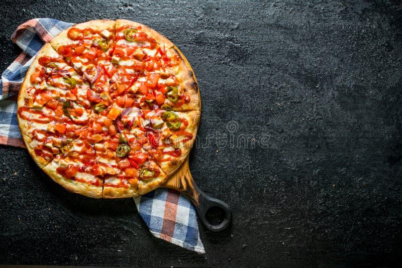 Pizza mexicaine avec une serviette photo stock