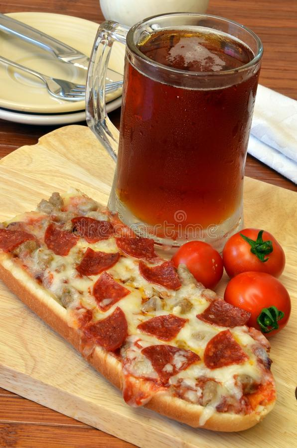 Download Pizza And Microbrew Meal stock image. Image of sports - 42683745