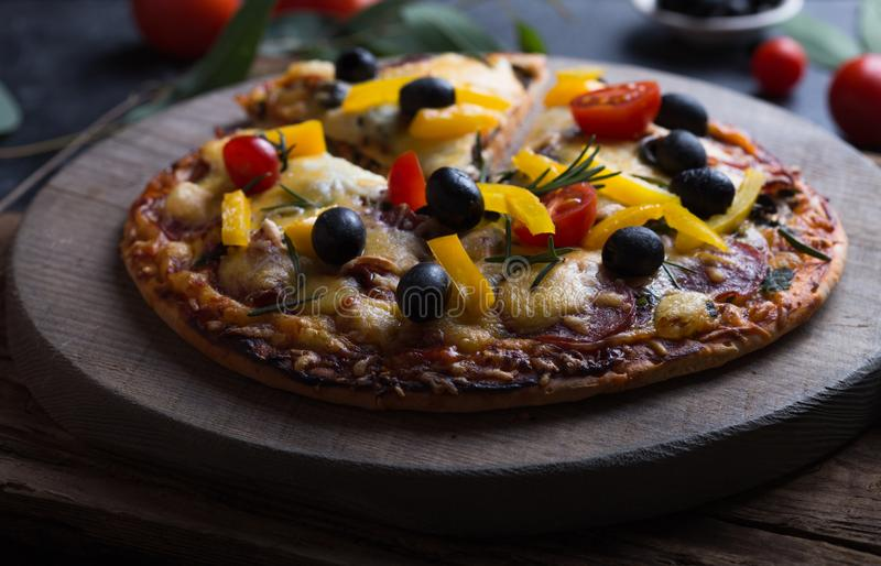 Pizza with mozzarella, mushrooms, black olives and fresh basil. Italian pizza. Homemade food. Symbolic image. Concept for a tasty. And hearty meal. Rustic stock photos