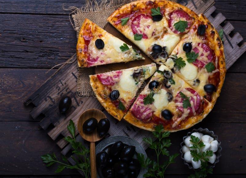 Pizza with mozzarella, mushrooms, black olives and fresh basil. Italian pizza. Homemade food. Symbolic image. Concept for a tasty. Pizza with mozzarella stock photo
