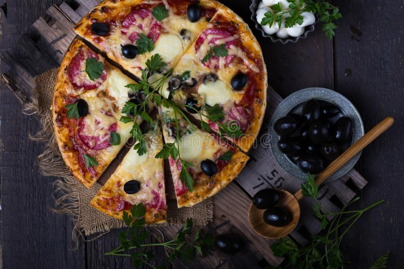 Pizza with mozzarella, mushrooms, black olives and fresh basil. Italian pizza. Homemade food. Symbolic image. Concept for a tasty. Pizza with mozzarella stock images