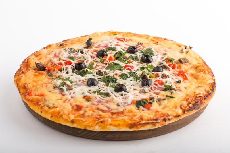 Pizza with mozzarella, mushrooms, black olives and fresh basil. Italian pizza. Homemade food. Symbolic image. Concept for a tasty. Pizza with mozzarella royalty free stock images