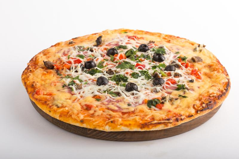 Pizza with mozzarella, mushrooms, black olives and fresh basil. Italian pizza. Homemade food. Symbolic image. Concept for a tasty. Pizza with mozzarella royalty free stock photography