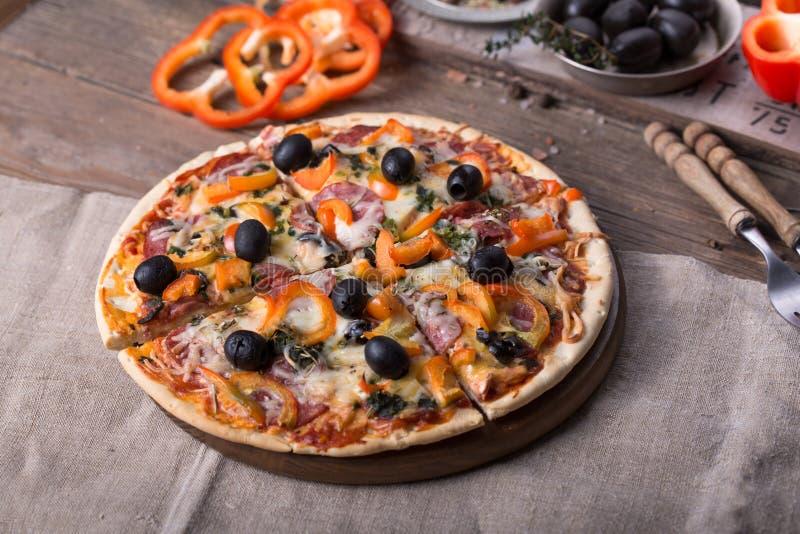 Pizza with mozzarella, mushrooms, black olives and fresh basil. Italian pizza. Homemade food. Symbolic image. Concept for a tasty. Pizza with mozzarella stock photography