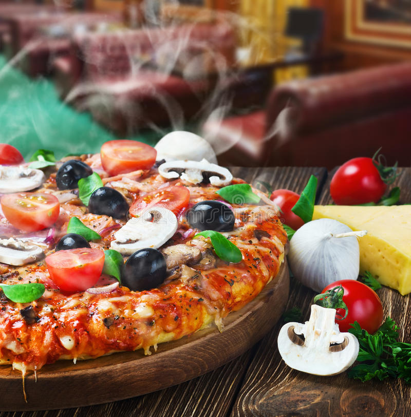 Pizza with mushrooms and cheese served royalty free stock photo