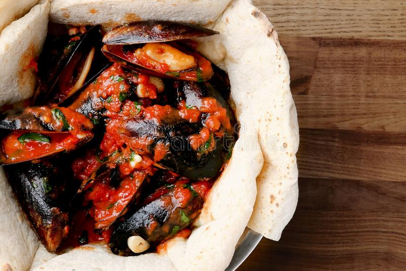 Pizza with mussels on table restaurant traditional pizza with basil leaf close up stock photos