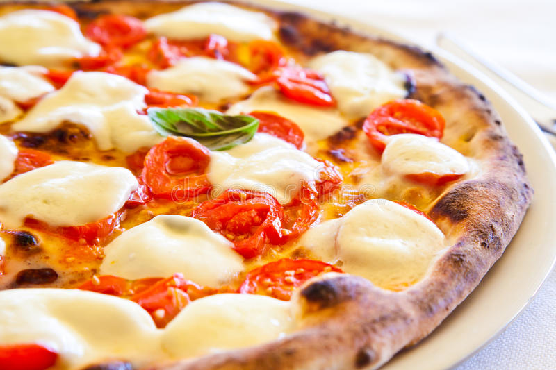 Pizza in Naples royalty free stock image