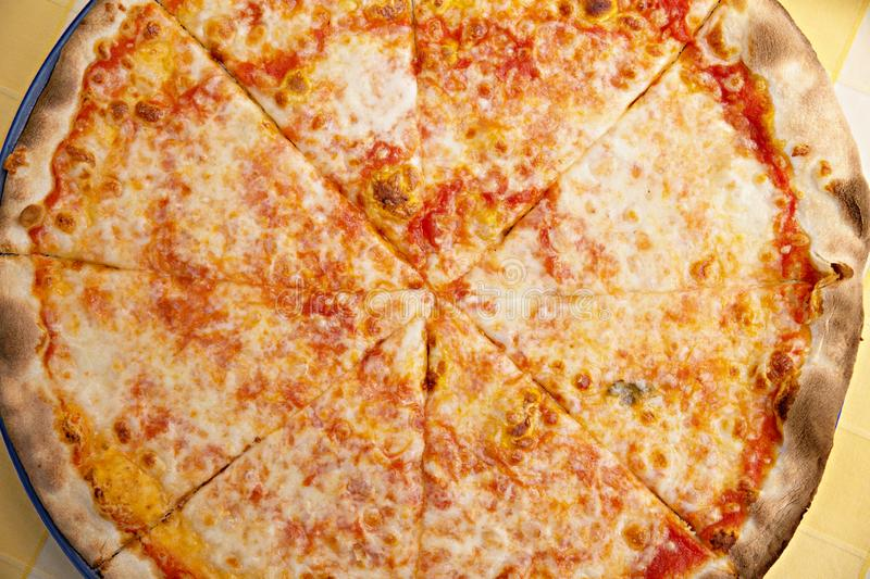 Pizza. One Tray on the tablecloth yellow, slice, food, eating, italian, fast, pepperoni, american, deluxe, dinner, meal, peppers, made, kitchen, crust, home stock photo