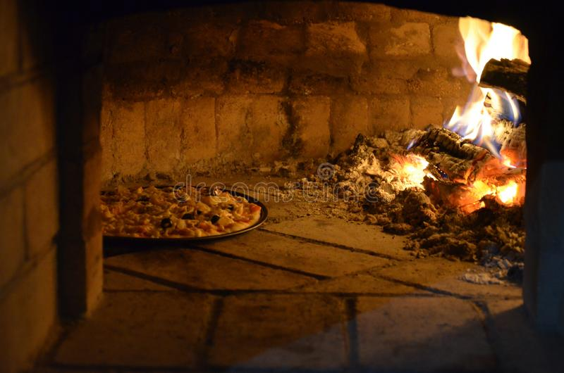 Pizza in the oven. With fire stock photo