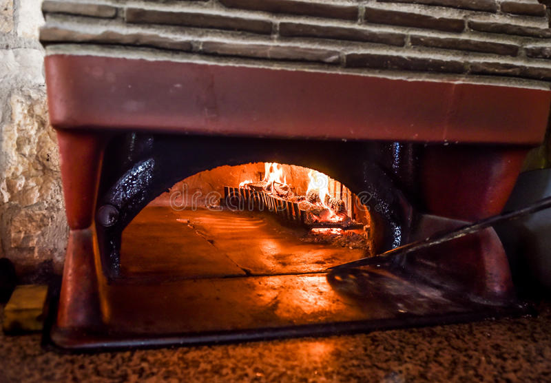 Pizza oven with natural firewood, coal and flame. Traditional old Pizza oven with natural firewood, coal and flame is ready for backing royalty free stock image