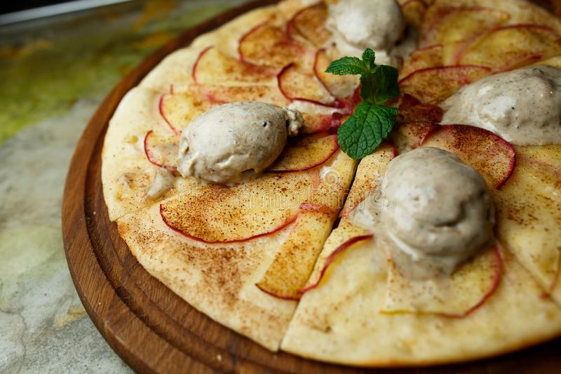 Pizza with pears and ice cream stock photos