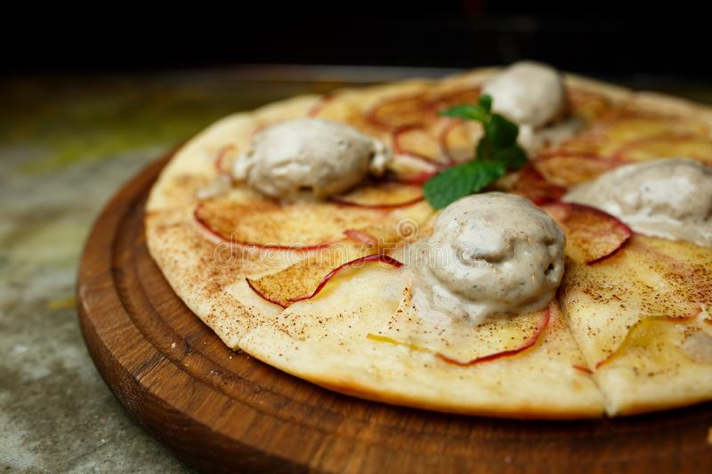 Pizza with pears and ice cream royalty free stock photo