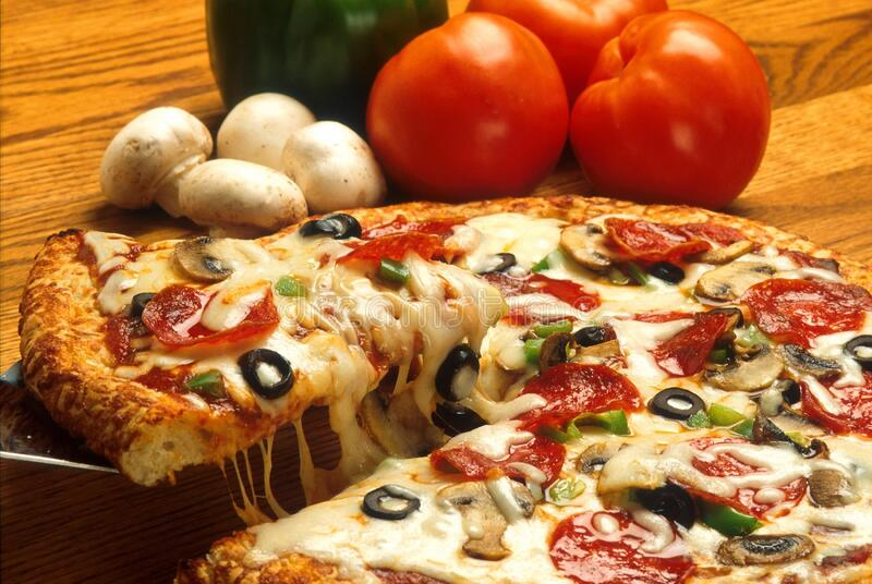 Pizza pie with fresh ingredients royalty free stock photography